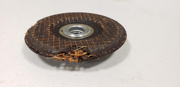 Grinding wheel with large chunk missing – Should not be used