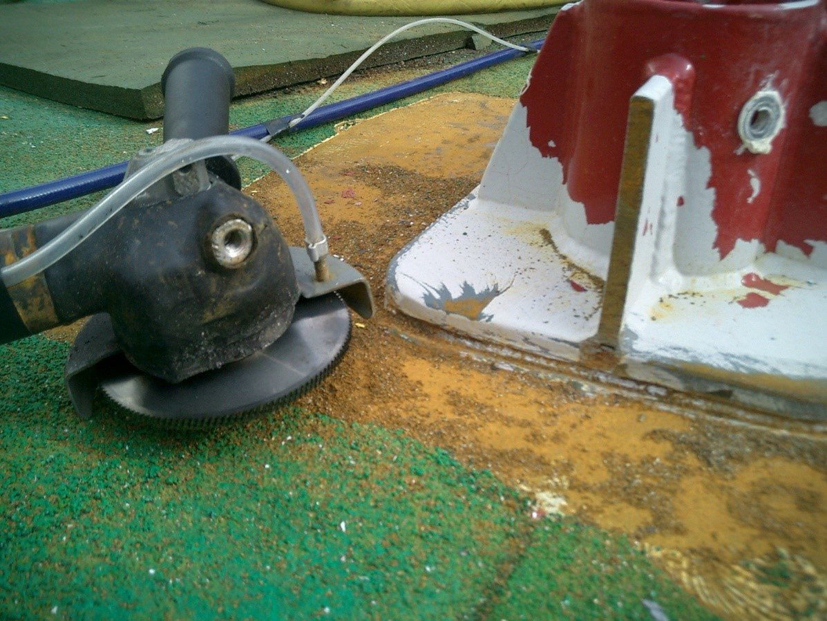 Halfway on the removal of the weld seam, notice the skid is not damaged.